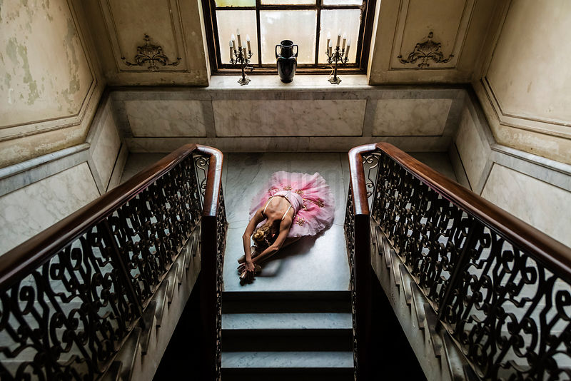 Ballerina in Vintage Tutu Posing on the Stairs of a Pre-Revolutionary Home