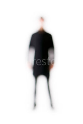 A blurred figure of a man standing – shot from mid level.