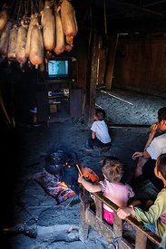 Watching TV in Hmong Village Hut