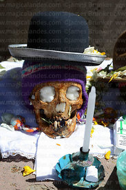 Skulls wearing bowler hat and woollen hat (called a chullu or chullo) at Ñatitas festival, La Paz, Bolivia