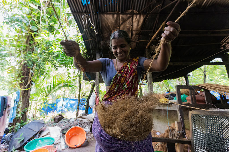 Woman Weaving Rope from Coconut Coir