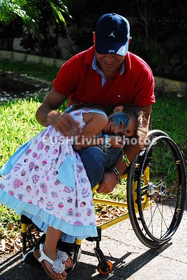 Man in a wheelchair with his daughter