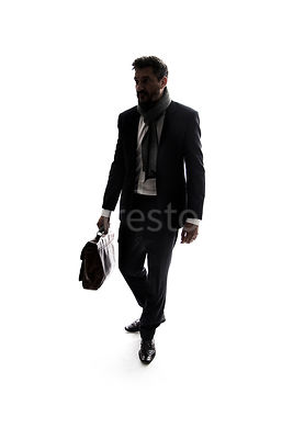 A mystery man in a suit, walking with a bag, in semi-silhouette – shot from eye level.