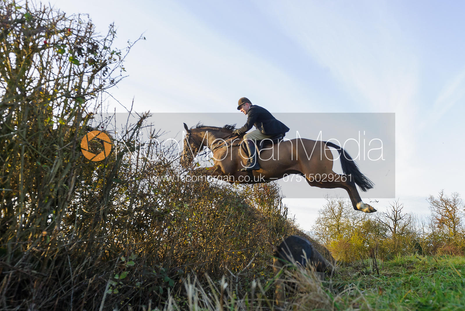 Matthew Mackley jumping a hedge on line 3
