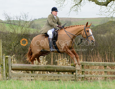 Johnnie Arkwright jumping a hunt jump near Peake's Covert