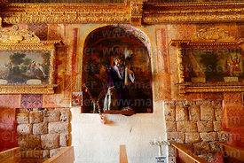 Statue of Jesus carrying cross and part of original Inca wall inside Church of the Immaculate Conception, Checacupe, Cusco Re...