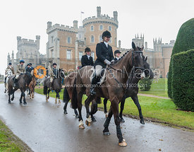Followers leave the meet with Belvoir Castle in the background