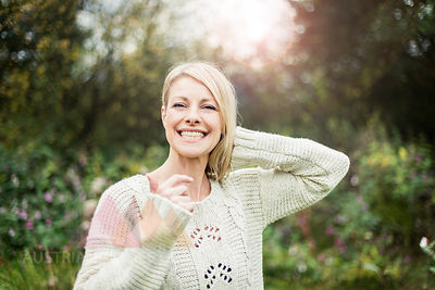 Portrait of happy blond woman outdoors