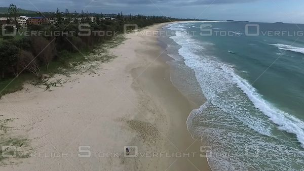 Couple Walking Along Beach Kingscliffe Australia