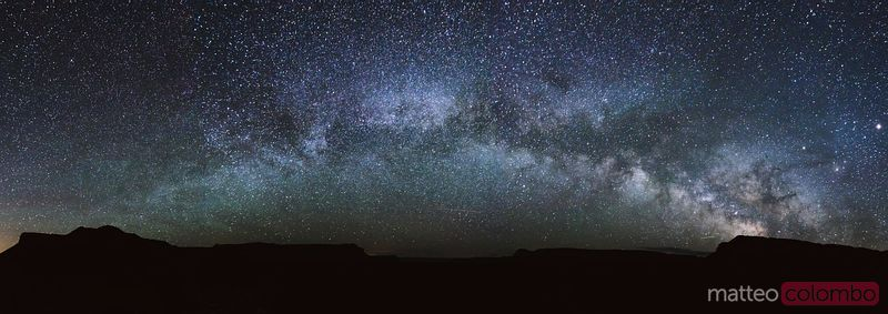 Panoramic of Milky way forming an arch, USA