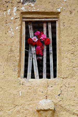 Floral cross in window of historic adobe church at Markacocha, Patacancha Valley, Cusco Region, Peru