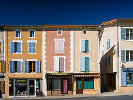 Cunlhat : colored facades of the marketplace