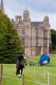 Competitor rides towards Burghley House - Burghley Horse trials 2011
