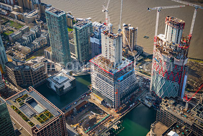 Aerial view of East London, Docklands with construction of Newfoundland tower and Landmark Pinnacle.