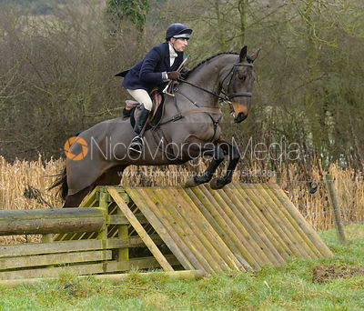 Sarah Wales jumping a hunt jump at Peakes - The Fitzwilliam Hunt visit the Cottesmore at Burrough House