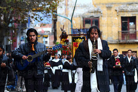 Musicians with brotherhood of Señor de las Caidas / The Fallen Christ during Good Friday procession, Plaza Murillo, La Paz, B...