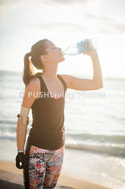 Young woman with a  prosthetic arm out jogging