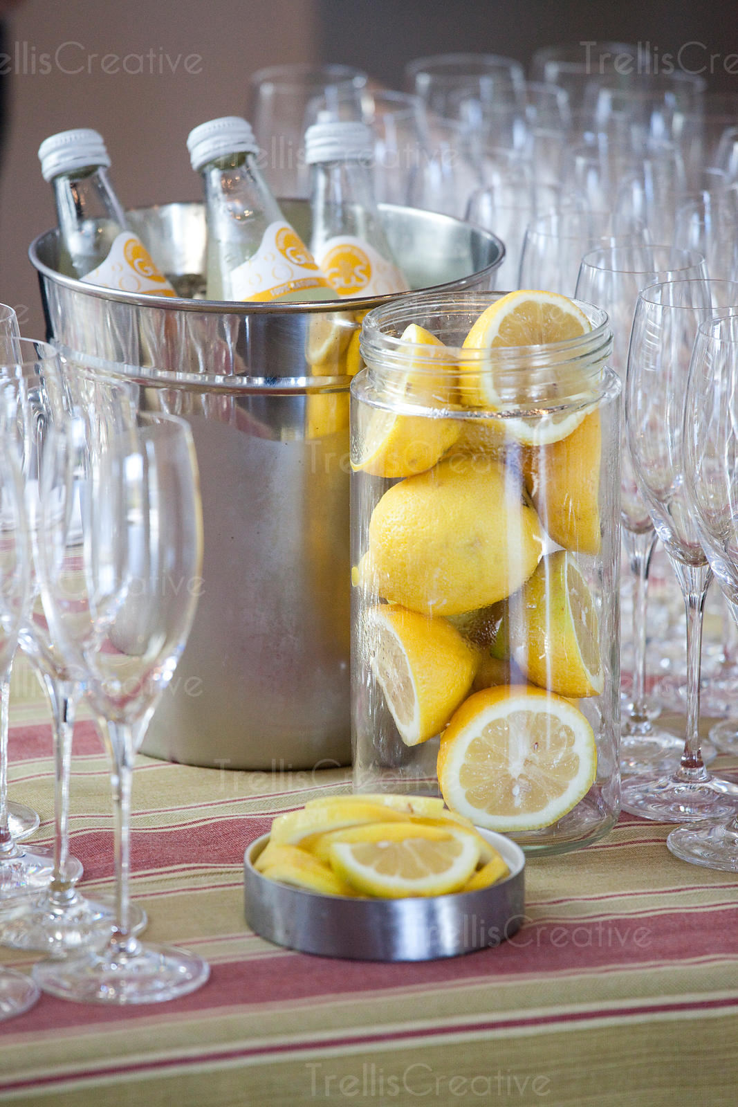 Fresh cut lemons served with sparkling water at a party