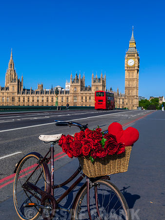 Bicycle with bunch of flowers and heart on Westminster Bridge , London, UK