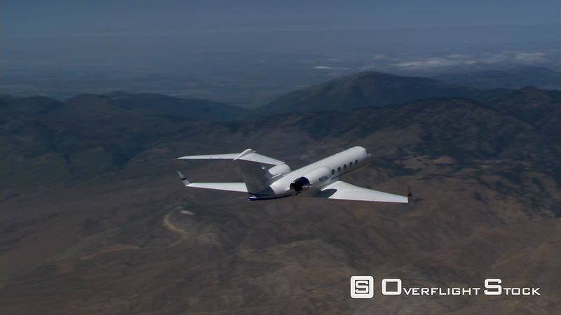 Air-to-air view of executive jet from rear