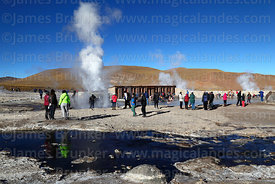 Tourists visiting the thermal baths area of El Tatio geyser field, Region II, Chile