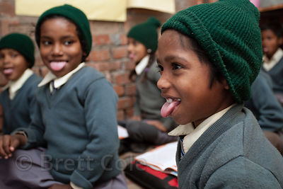 Students stick out their tongues while doing exercises at a school in Varanasi, India operated by Dutch NGO Duniya (duniya.org).