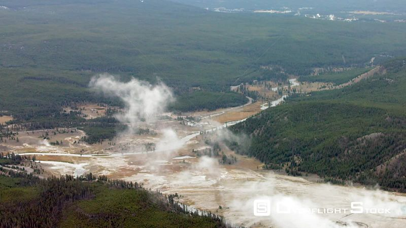 Grand Prismatic Spring and Excelsior Geyser in the Midway Geyser Basin sit next to the Firehole River in Yellowstone National...