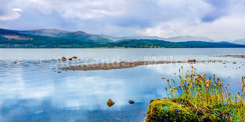 Cloud reflections in the waters of Loch Rannoch looking across to beautiful Scottish rolling hills