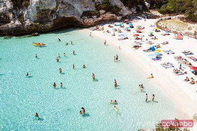 Elevated view of Cala Macarelleta beach crowded, Menorca