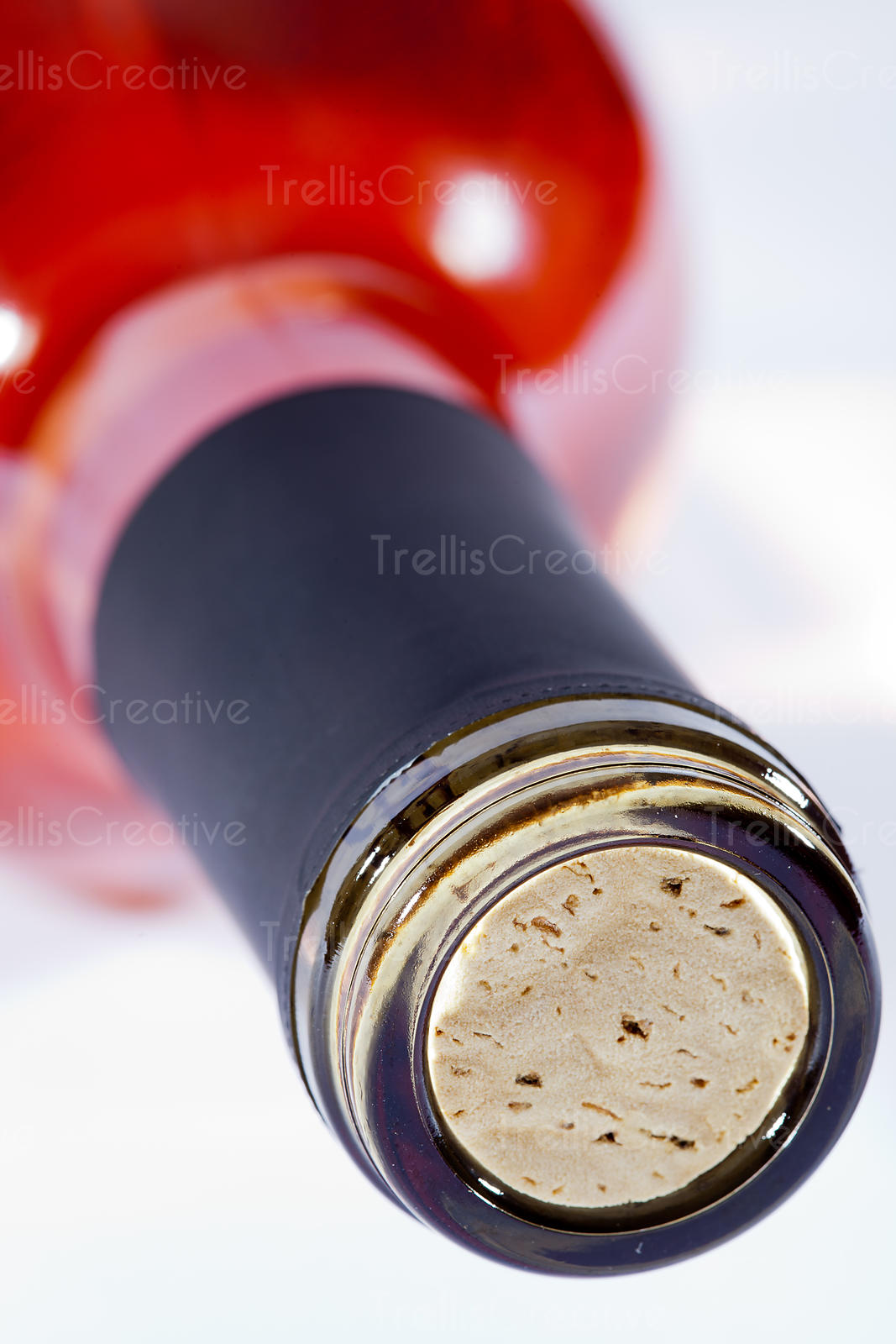 Close-up of the neck of a bottle of white zinfandel with oak cork