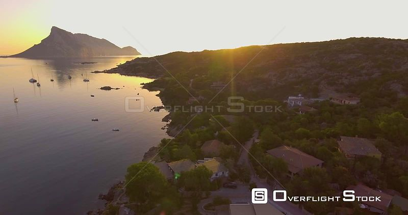 Aerial, beautiful bay in Sardinia with the view on Tavolara island on sunrise, 4K