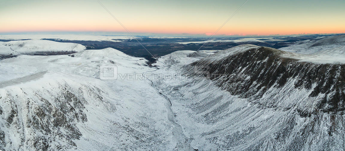 Aerial view of the Lairig Ghru pass at sunrise, Cairngorms National Park, Scotland, UK, November 2016.