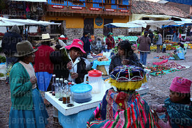 Lady selling hot drinks from cart at Pisac market, Sacred Valley, Cusco Region, , Peru