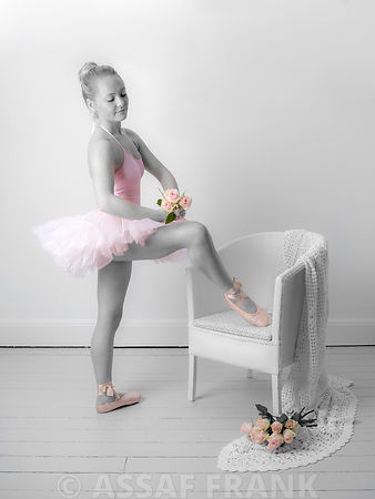 Professional ballet dancer with Roses standing by a chair