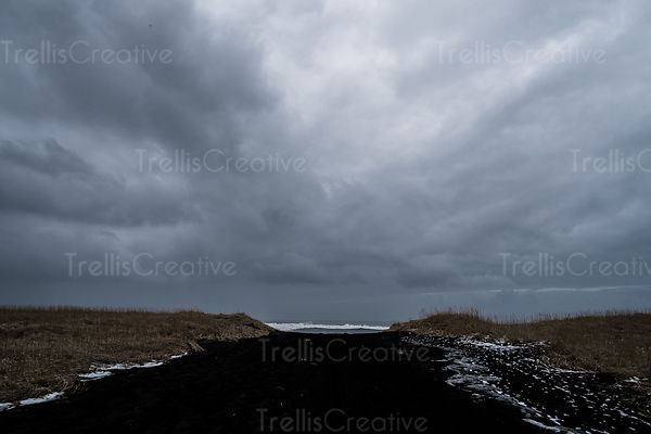 Storm looms over the black sand beach in Vik, Iceland