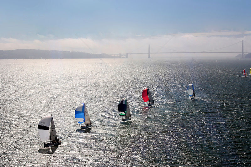 Fleet of yachts with spinnakers, and Bridge in the background. San Francisco to Vallejo Race, San Francisco Bay, California. ...