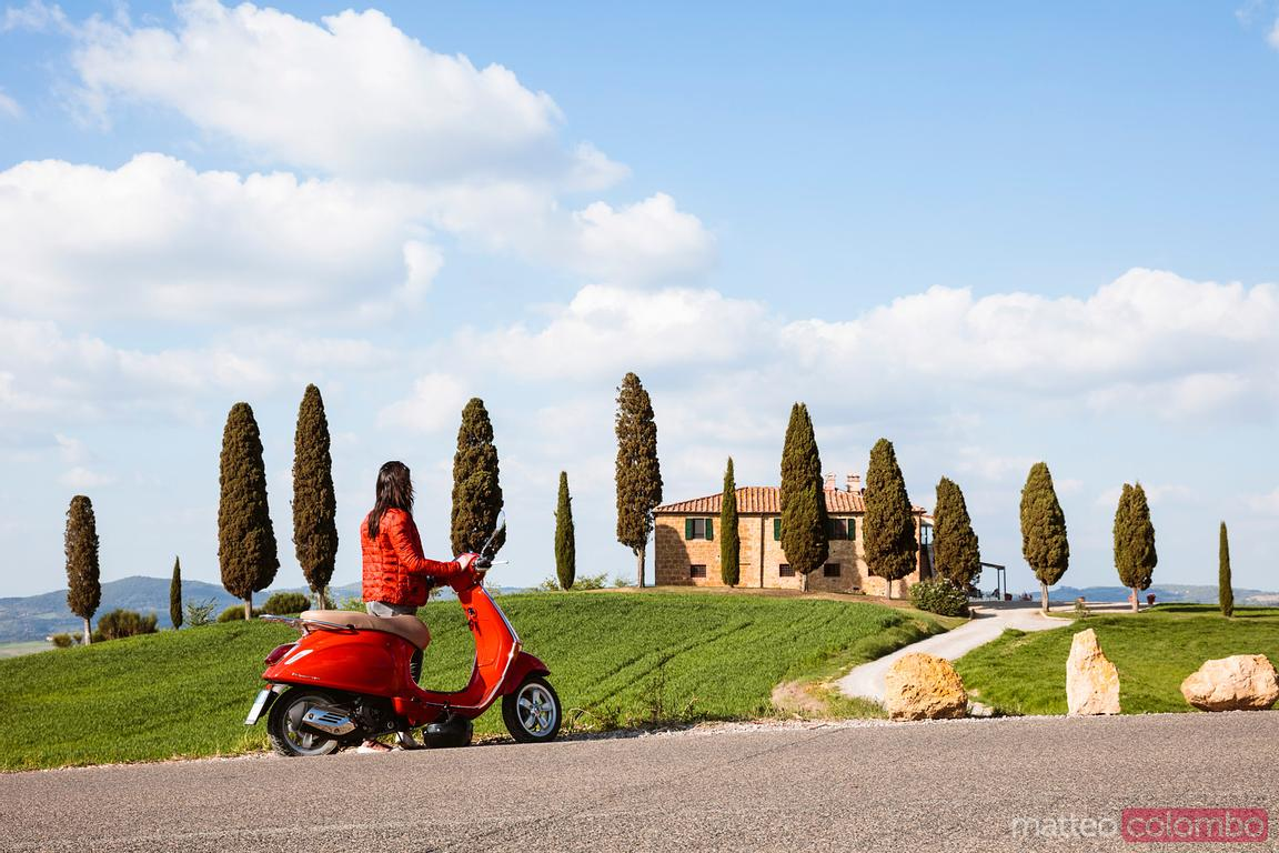 Tourist riding a motorcycle in Tuscany, Italy