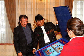 Bolivian president Evo Morales presents American actor Sean Penn with a traditional textile as a gift at the Presidential Pal...