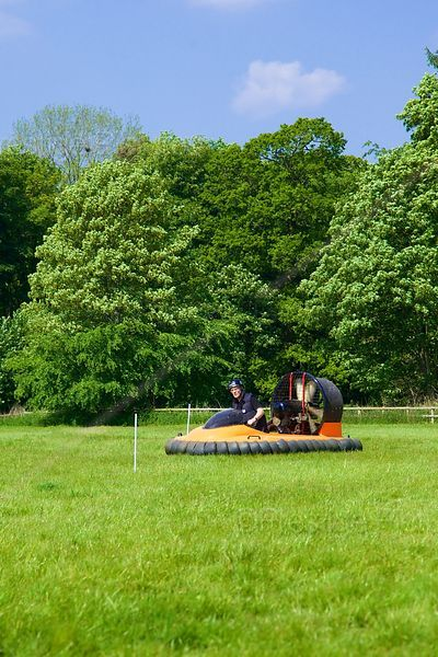 Small Hovercraft driving over Grassland