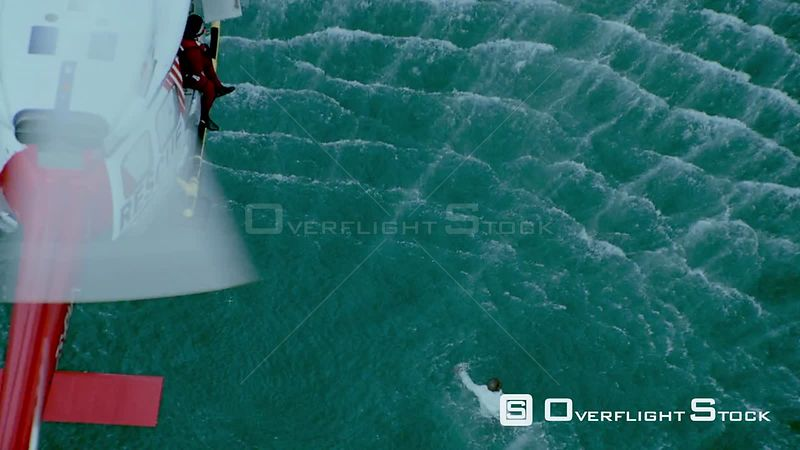 Aerial of a rescue helicopter hovering above a man struggling in the sea Cape Town Western Cape South Africa