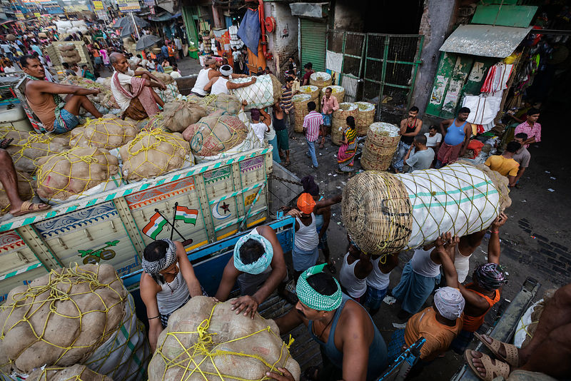 Porters or Coolies Unloading Sacks of Vegetables to be Distributed at the Koley Wholesale Market