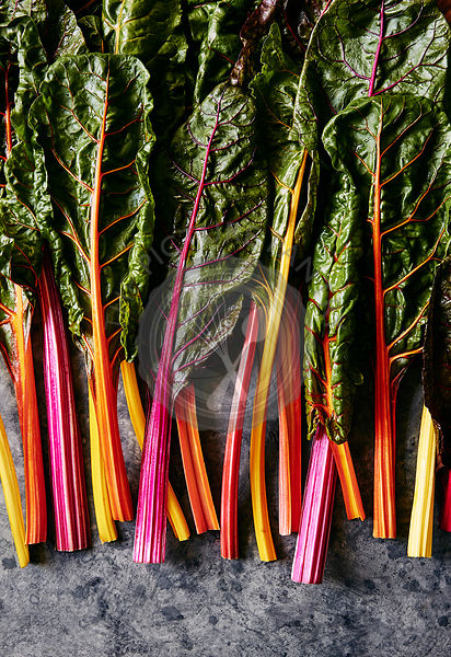 Freshly picked rainbow chard with multicoloured stems.