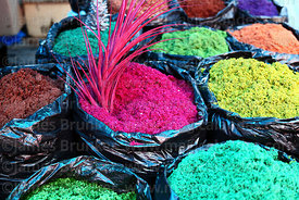Coloured sawdus for making nativity scenes for sale in Christmas market, Bolivia
