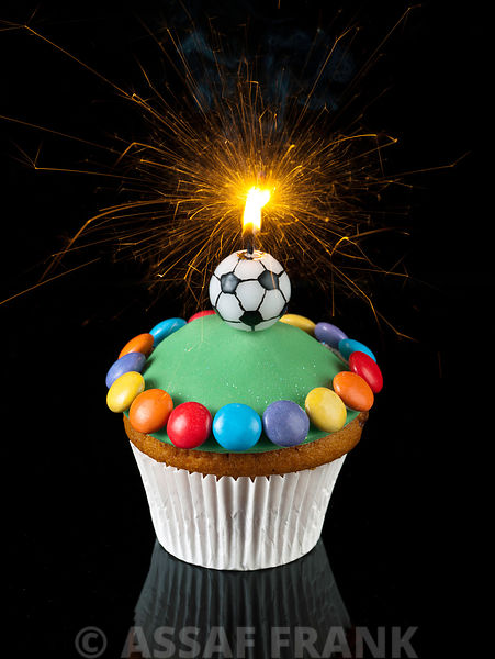 cupcake with football shaped candle