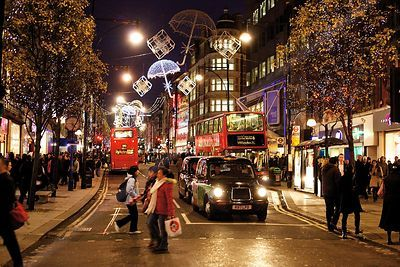 Christmas Shoppers at Night in Oxford Street