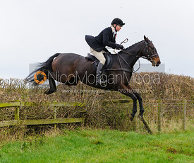 Adrienne Coombe jumping at Stone Lodge Farm - The Cottesmore Hunt at Tilton on the Hill, 9-11-13