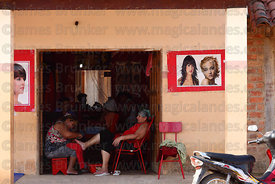 Lady getting a pedicure in doorway of beauty parlour, San Ignacio de Moxos, Beni, Bolivia