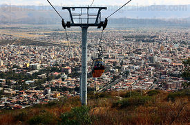 Cable cars descending from Cerro San Pedro to city , Cochabamba , Bolivia