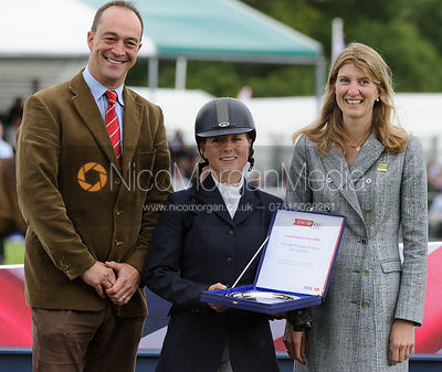 Alex Postolowsky receives the HSBC Bursary prize - Burghley Horse Trials 2013.