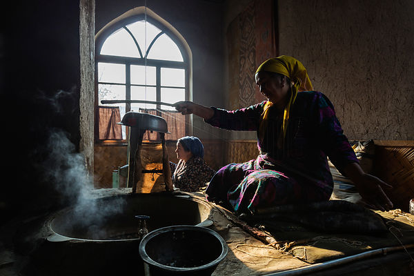 Women Spinning Silk from Silkworm Cocoons in the Ancient Way